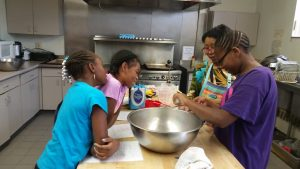 corla-and-kids-in-kitchen